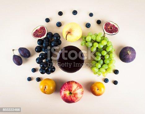 istock Grape juice with autumn seasonal fruits. 855333466