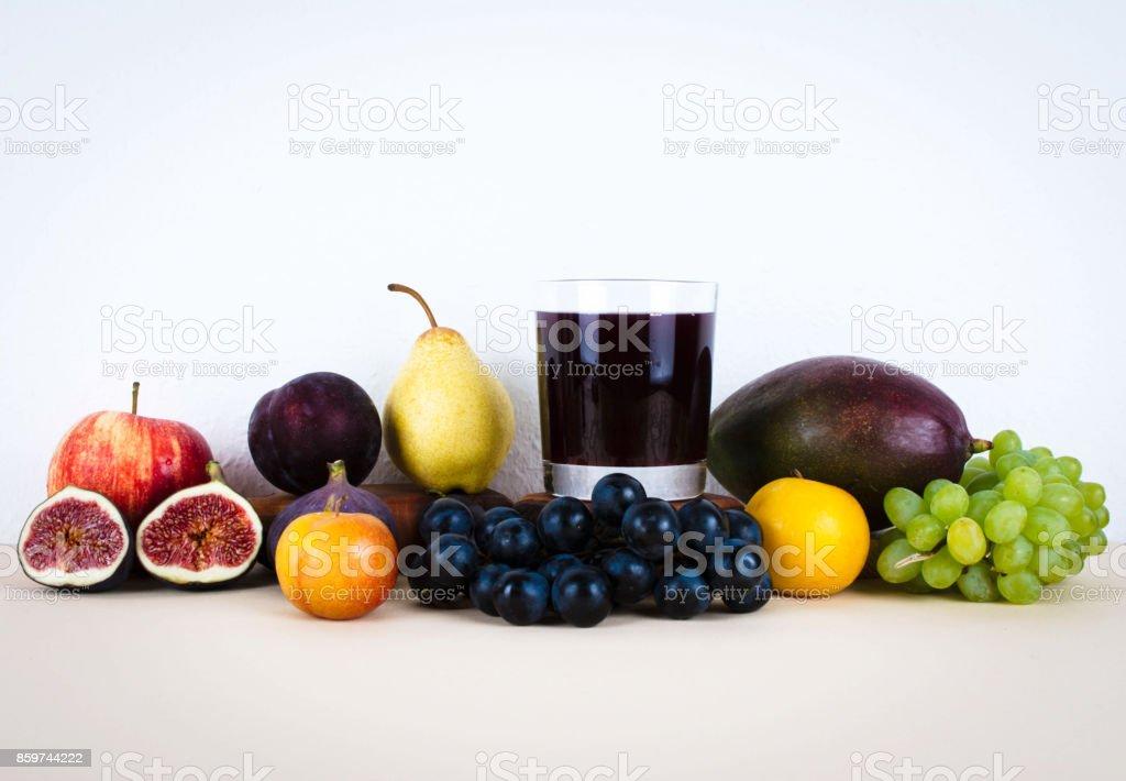Grape juice with autumn seasonal fruits. stock photo