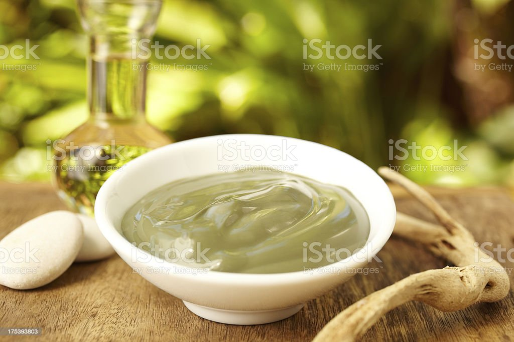 Grape seed oil and avocado mud mask spa treatment royalty-free stock photo