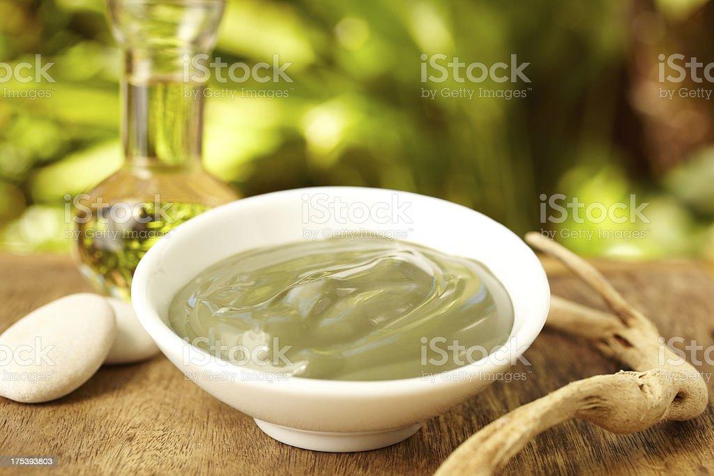 Grape seed oil and avocado mud mask spa treatment stock photo