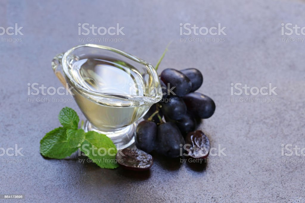 grape seed oil in a glass sauce vessel royalty-free stock photo