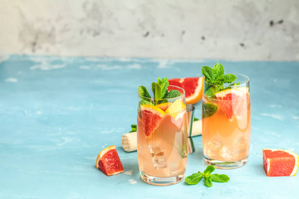 Grapefruit and fresh mint cocktail with juice stock photo
