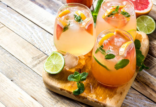 Grapefruit and mint gin cocktail, refreshing drink stock photo
