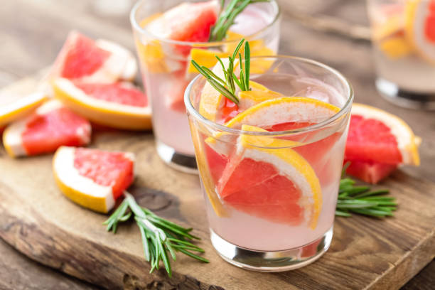 grapefruit and rosemary cocktail - grapefruit cocktail stock photos and pictures