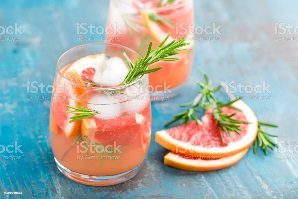 Grapefruit and rosemary gin cocktail, refreshing drink with ice stock photo