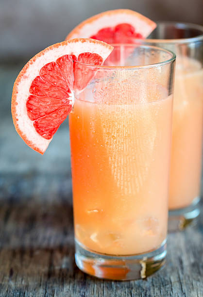 grapefruit and tequila paloma cocktail - grapefruit cocktail stock photos and pictures