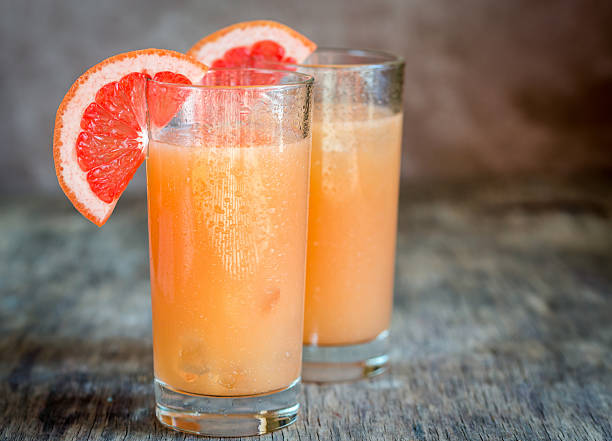 grapefruit and tequila paloma cocktails - grapefruit cocktail stock photos and pictures