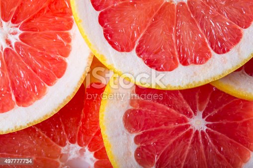 background made with a heap of sliced grapefruits