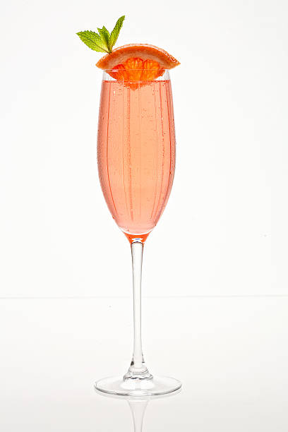grapefruit champagne bellini - grapefruit cocktail stock photos and pictures