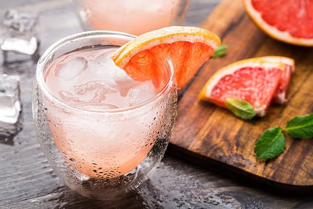 grapefruit cocktail - grapefruit cocktail stock photos and pictures