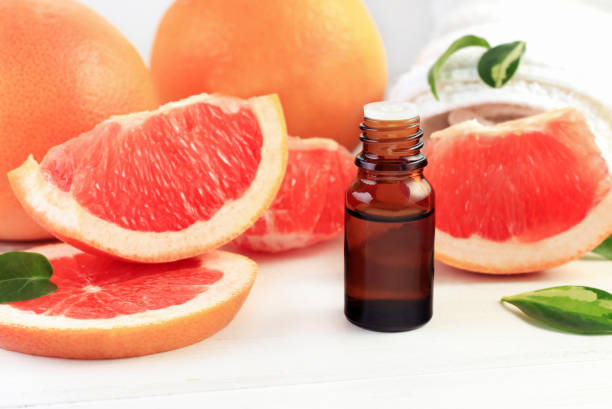 Grapefruit fragrance oil in apothecary dark glass dropper bottle stock photo