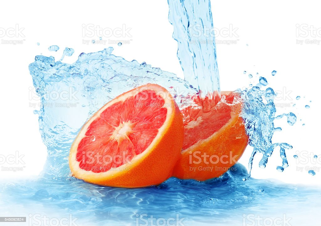grapefruit in a spray of water stock photo