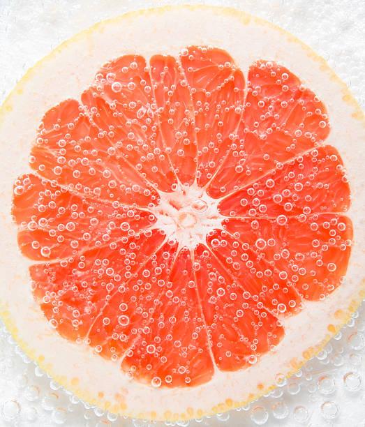 グレープフルーツの泡 - グレープフルーツ ストックフォトと画像