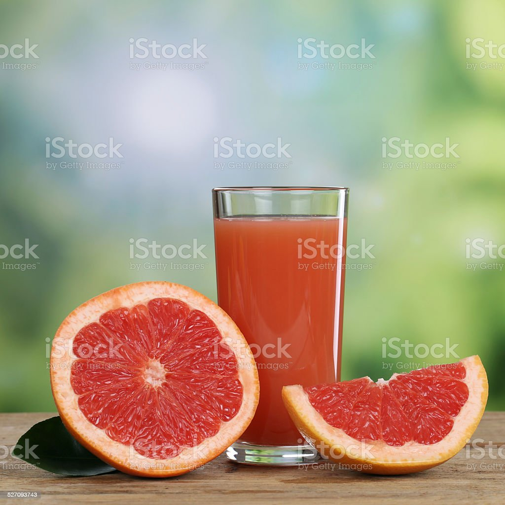 Grapefruit juice and fresh grapefruits fruits in summer stock photo