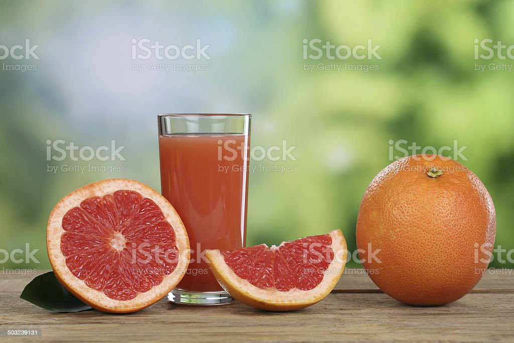 Grapefruit juice and fresh grapefruits in summer stock photo