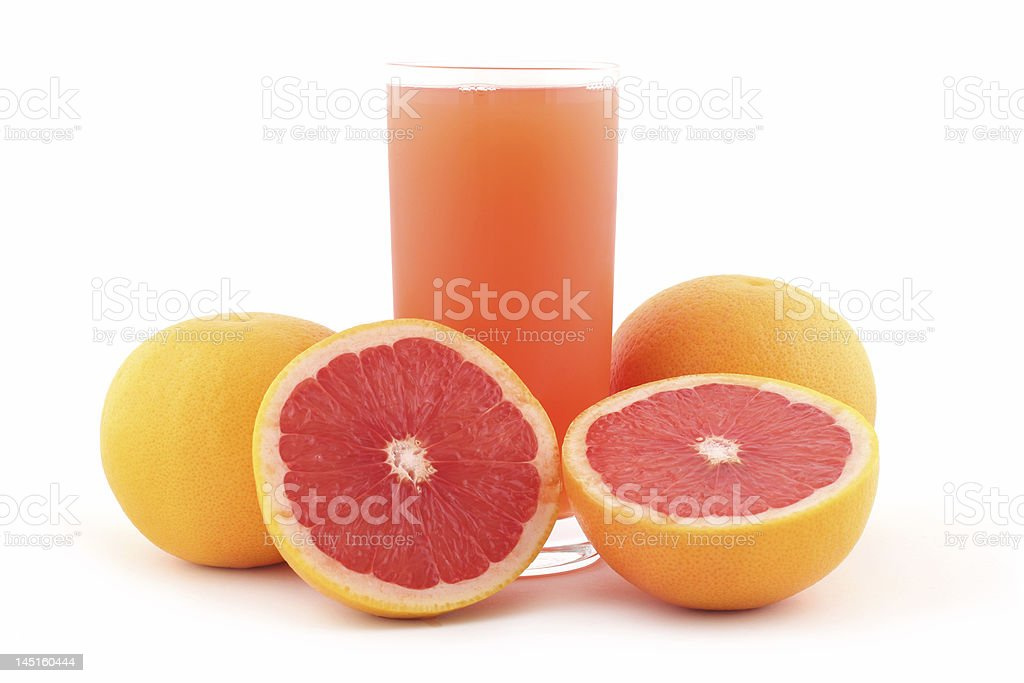 Grapefruit juice and ripe grapefruits stock photo