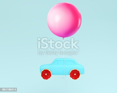 903520476 istock photo Grapefruit layout wheel and car blue with pink balloon floating on pastel blue background. minimal idea food and fruit concept. Idea creative to advertising marketing communications. 954166414