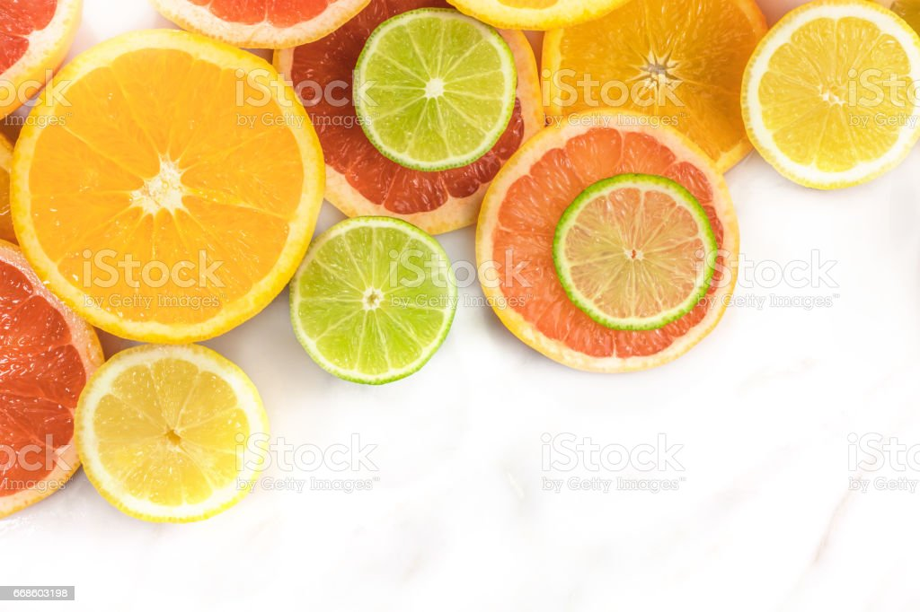 Grapefruit, lime, lemon, and orange slices with copyspace stock photo
