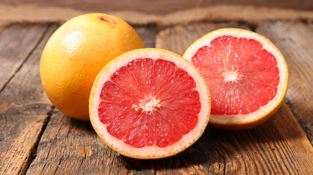 grapefruit on wood background stock photo