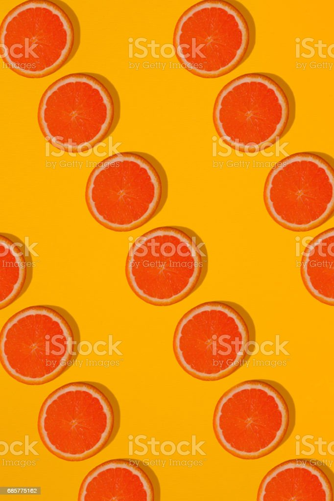 Grapefruit pattern on yellow background. Minimal flat lay concept royalty-free stock photo