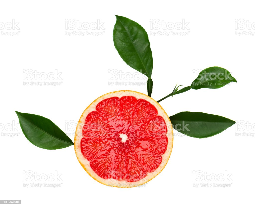 Grapefruit piece isolated on white background. Fresh fruit. With clipping path. Fresh grapefruit with green leaves isolated. stock photo