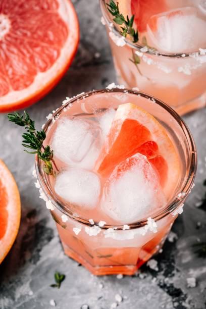 grapefruit salty dog cocktail - grapefruit cocktail stock photos and pictures