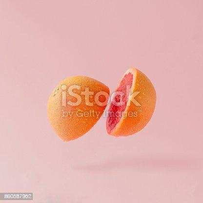istock Grapefruit sliced on pastel pink background. Minimal fruit concept. 860587952
