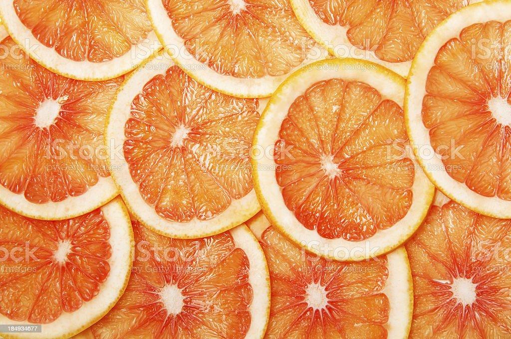 grapefruit slices background royalty-free stock photo