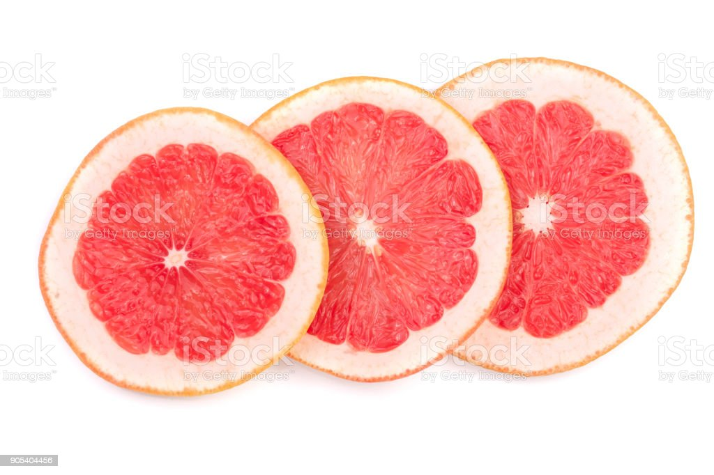 Grapefruit slices isolated on white background. Top view stock photo