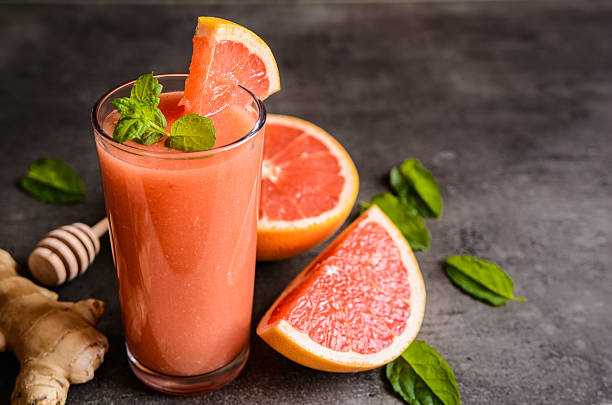 Grapefruit smoothie with ginger and honey stock photo