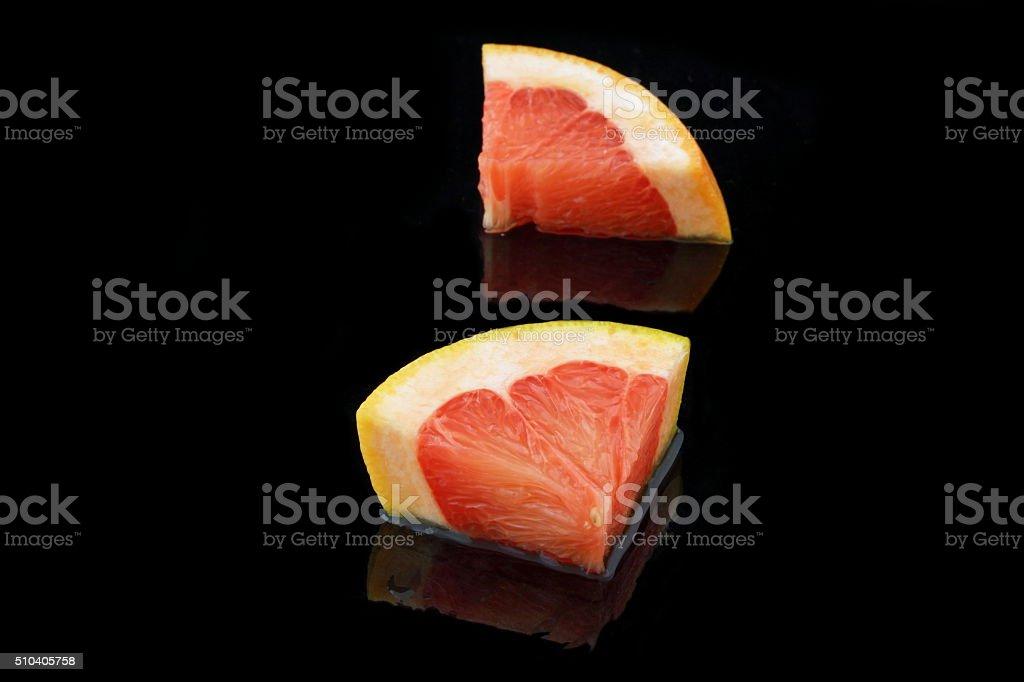 grapefruit stücke stock photo