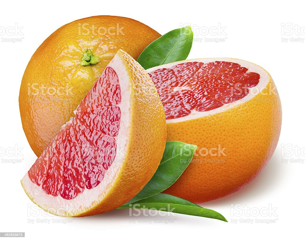 Grapefruit with a half and leaves on white background stock photo