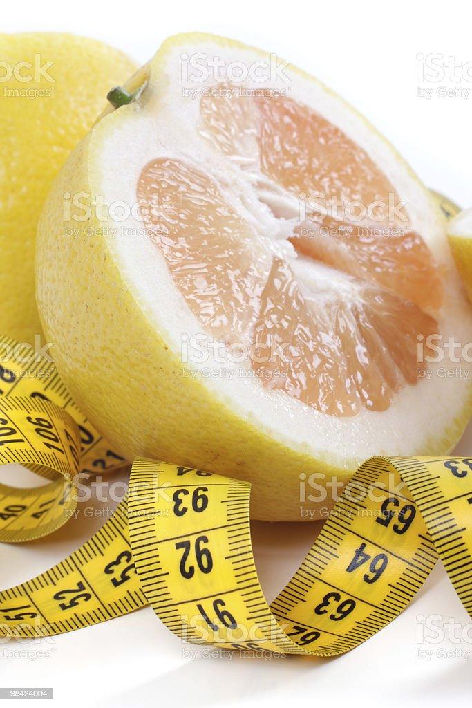 Grapefruit with centimetre. royalty-free stock photo