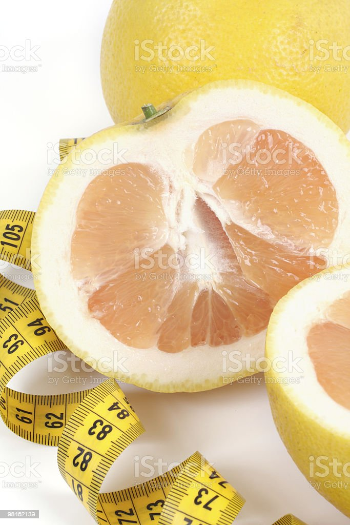 Grapefruit with centimetre. royalty-free stock photo