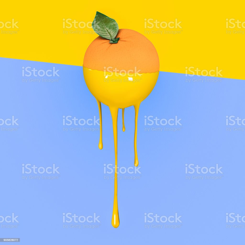 Grapefruit with dripping yellow paint on pastel blue and  yellow background. Minimal food concept. stock photo