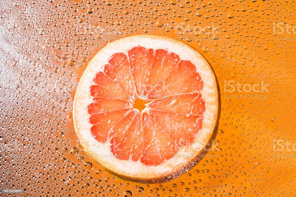 Grapefruit with water drops stock photo