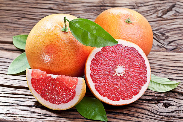 Grapefruits with leaves. stock photo