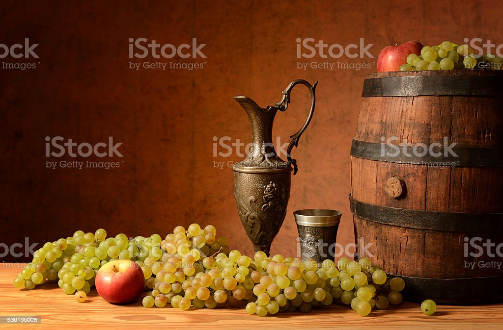 Grapes, a carafe for wine stock photo
