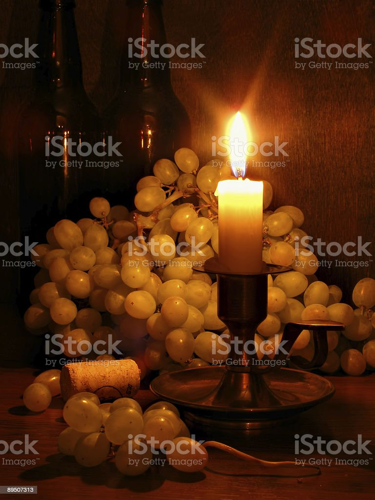 Grapes and candle royalty-free stock photo