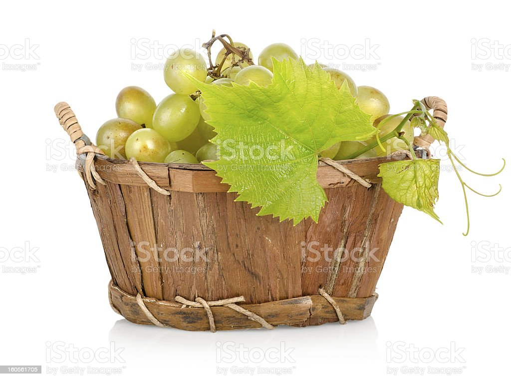 Grapes in a basket isolated royalty-free stock photo