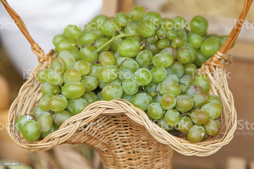 grapes in a basket royalty-free stock photo