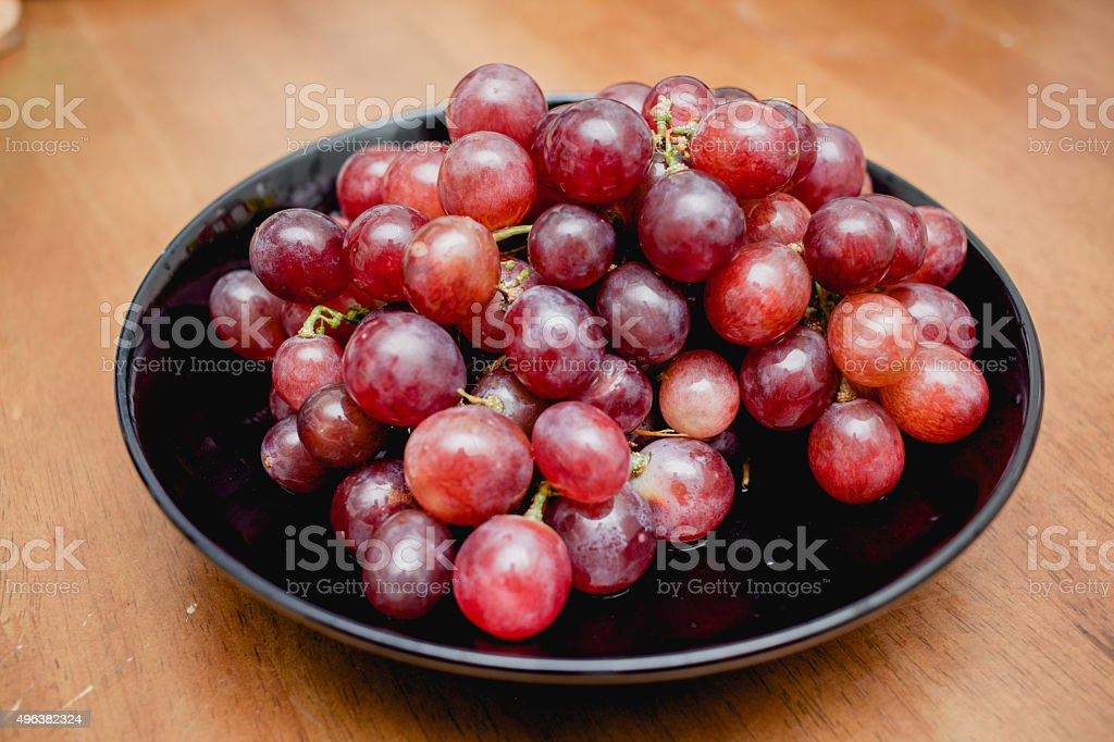Grapes in a black plate stock photo