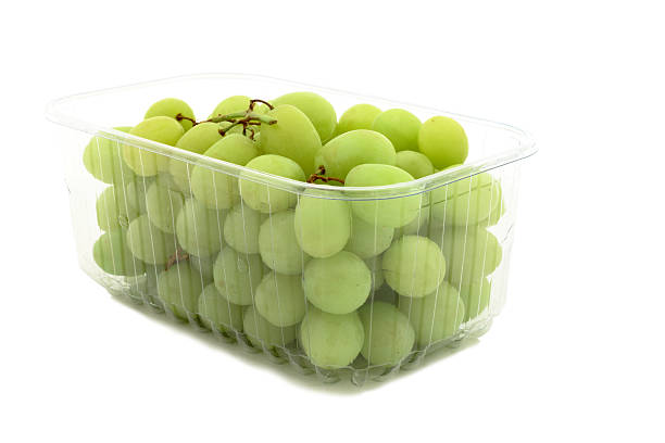Grapes in a plastic punnet on white background  fruit carton stock pictures, royalty-free photos & images