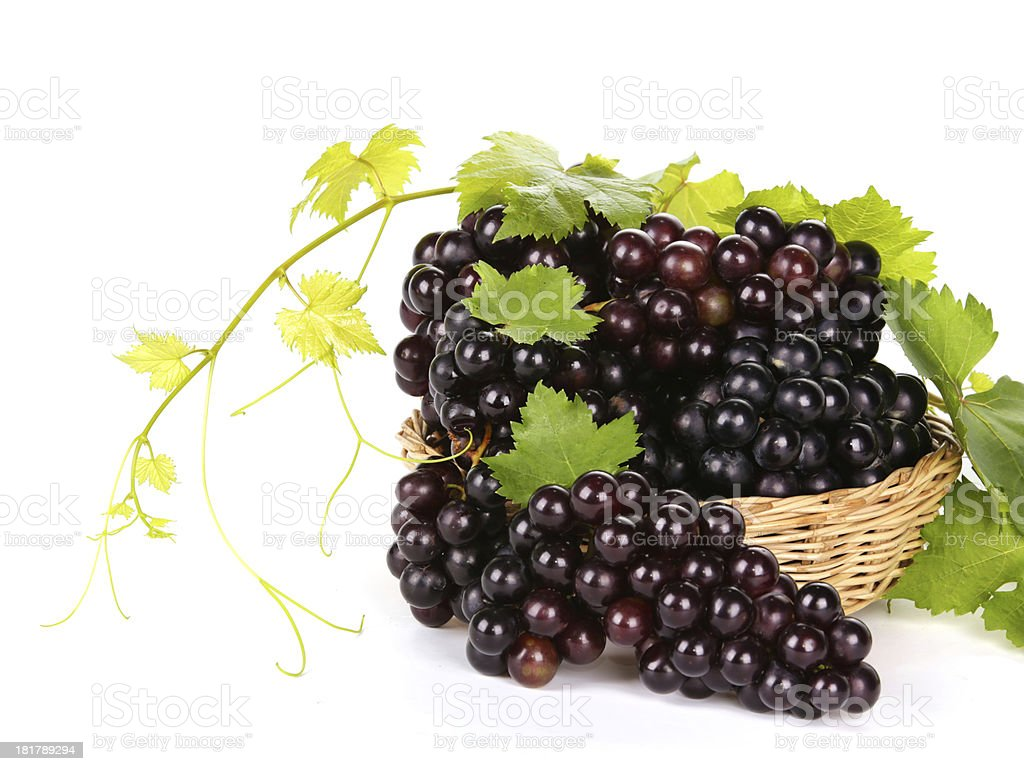 Grapes in basket with leaf on white background royalty-free stock photo
