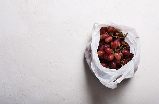 Grapes In Plastic Bag On A White Background With Copy Space Stock ...