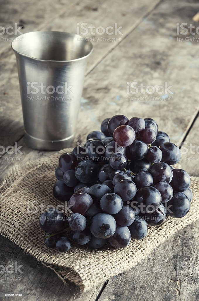 Grapes on a old wooden table. royalty-free stock photo