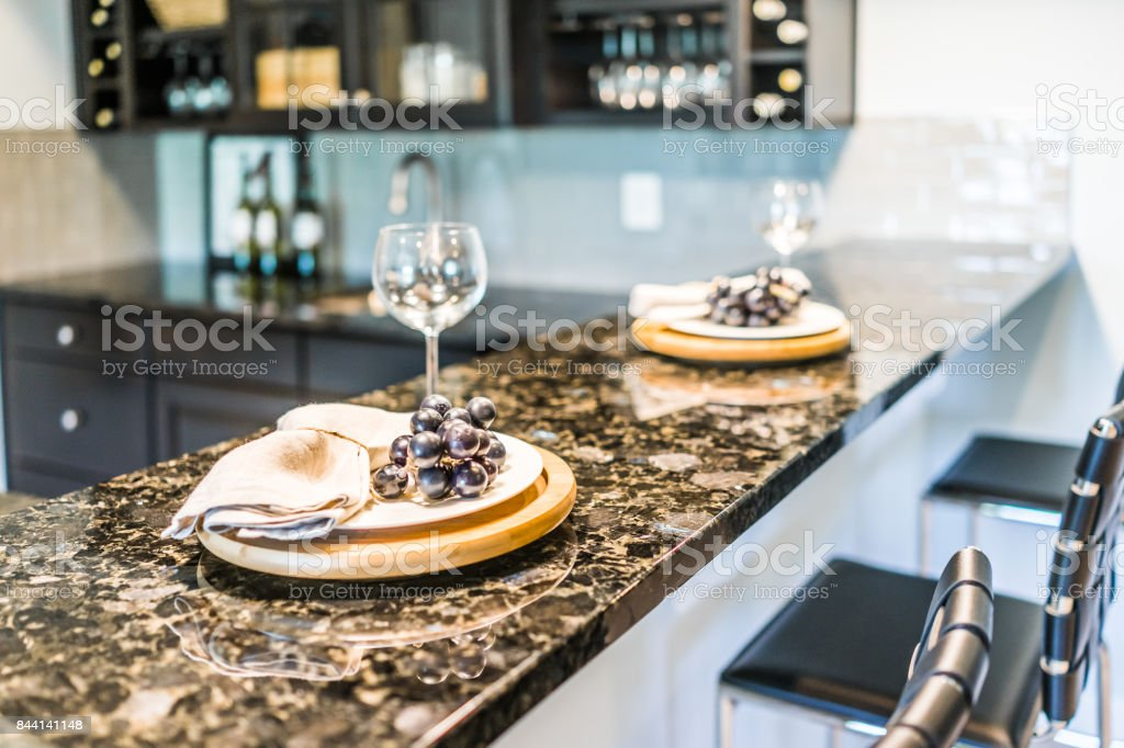Grapes on plate of modern granite kitchen bar in luxury apartment or restaurant stock photo