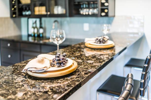 grapes on plate of modern granite kitchen bar in luxury apartment or restaurant - kitchen counter imagens e fotografias de stock