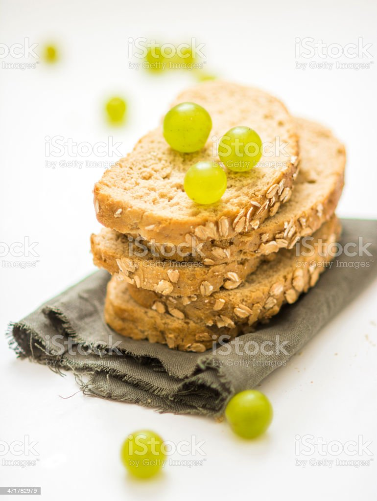Grapes over the Sliced Breads royalty-free stock photo