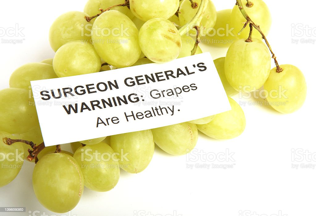 Grapes with health warning royalty-free stock photo
